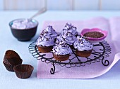Mini chocolate cupcakes with purple buttercream