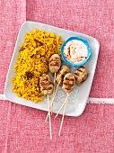 Curried rice with koftas and yoghurt sauce