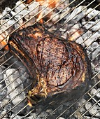 Barbecued beef steak on the barbecue