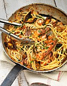 Linguine with seafood in a pan