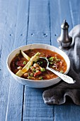Chorizo and chickpea soup with avocado