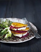 A butternut squash, beetroot and goat's cheese tower