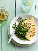 Grilled halloumi with rocket, edamame, capers and pine nuts