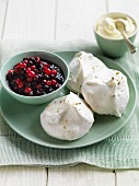 Meringues with berry compote and whipped cream