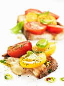 Bruschetta topped with red and yellow tomatoes