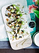 Sardine and cucumber skewers with lemony yoghurt dressing