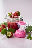 Strawberry and wild strawberry jam in a preserving jar