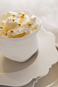 French meringues with golden pearls in a white bowl