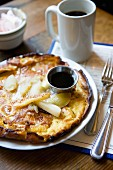 Apple pie with maple syrup and coffee