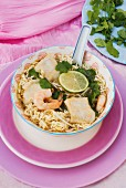 Oriental noodle soup with fish and prawns