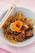 Stir-fried noodles with pork and sesame seeds