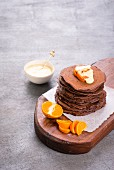 Chocolate pancakes with clementines and vanilla sauce