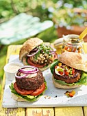 Various hamburgers on a garden table