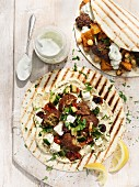 Wraps with falafel and lamb and chicken skewers