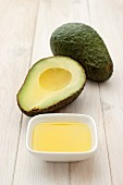 Avocado oil and fresh avocados