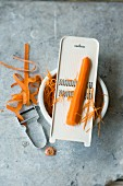 A carrot peeler and a grater