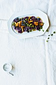 A purple potato salad with chanterelle mushroom vinaigrette