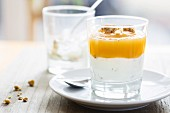 Greek yoghurt with crunchy muesli and homemade apple sauce in a glass