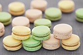 Macaroons with lemon curd, pistachio cream and white chocolate and raspberry cream