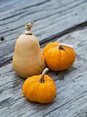 Fresh pumpkins on a wooden surface