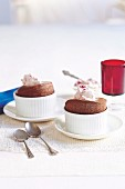 Chocolate souffles with raspberry cream