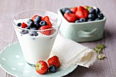 Fresh yoghurt with strawberries and blueberries