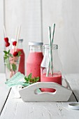 Smoothies made from raspberries, grapefruit, buttermilk and nutritional yeast