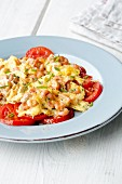 Shrimp scrambled eggs with fresh plum tomatoes