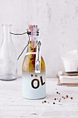 Spiced oil in a decoratively sprayed gift bottle