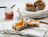 Hot cross buns with butter and marmalade