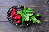 Fresh radishes in a basket (seen from above)