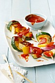 Vegetarian halloumi skewers with peppers and courgettes