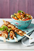 Chicken satay with an oriental vegetable salad