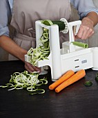 Vegetable noodles being made with a spiral cutter
