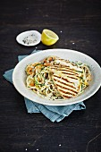 Vegetable noodles with sesame seeds and grilled halloumi