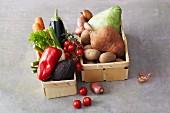 An arrangement of various vegetables in wooden baskets