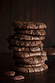 A stack of chocolate and pecan nut cookies