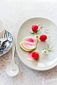 Radish and melon salad with raspberries