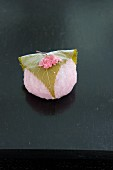 Sakura mochi with a cherry leaf (traditional sweet for the cherry blossom festival, Japan)