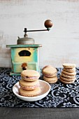 Macaroons in front of an old coffee grinder