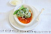 Wild garlic dumplings with tomato sauce and grated cheese