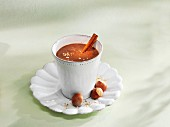 A chocolate and banana smoothie with hazelnuts and cinnamon
