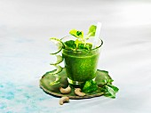 A cucumber and mint smoothies with lamb's lettuce and cashew nuts