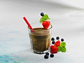A spinach smoothie with berries and bananas