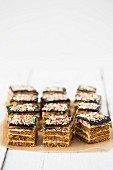 Layer cake with honey cream, ganache and colourful sugar sprinkles