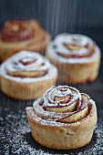 Shortcrust apple roses with icing sugar
