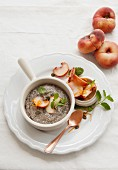 Almond, coconut and chia seed pudding with peach and mint salsa
