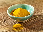 Turmeric powder in the ball and on a spoon