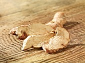 Galangal on a wooden surface