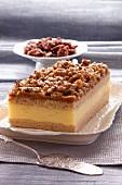 Custard cream cake with caramelised walnuts